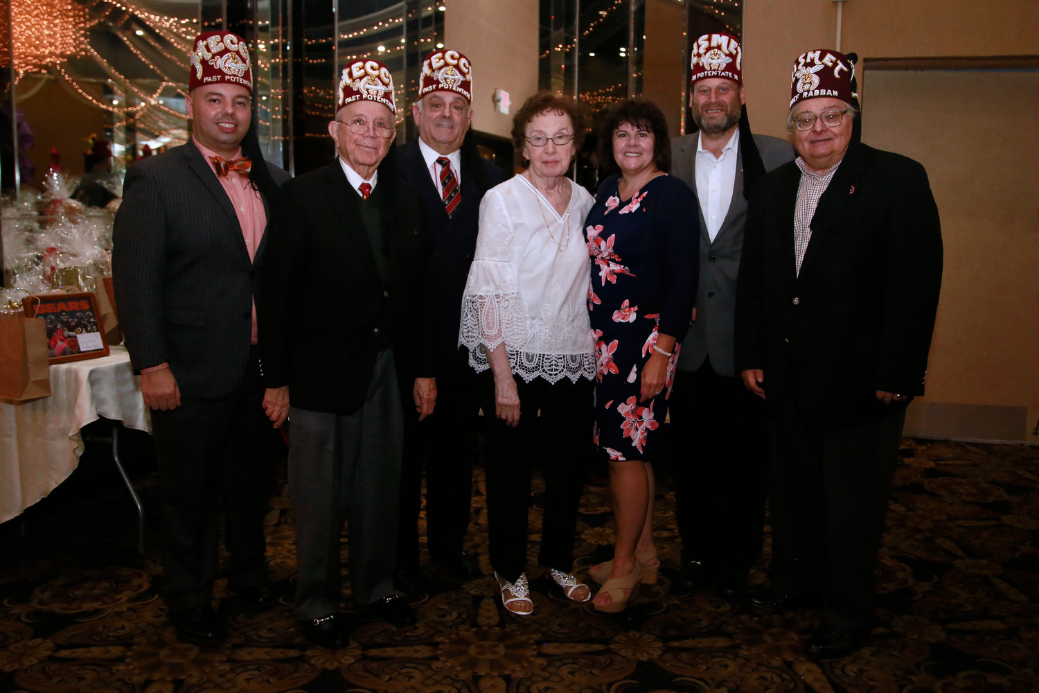 Klein, center, with Shriners Hospitals for Children representatives, from left, Avery Toledo, Ted Jacobsen, Ron Sablosky, Terry Diamond, Greg Feldman and Robert D'Carlo.