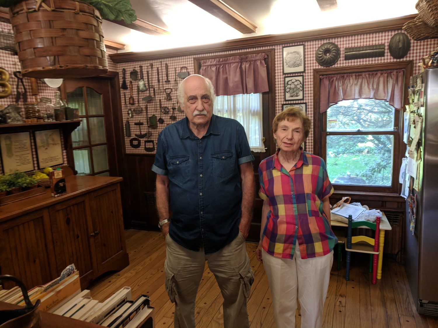 Gloria and Steve Bryan are seeking to have their home designated a historic landmark. Despite new floors, the interior gives off an old-time vibe.