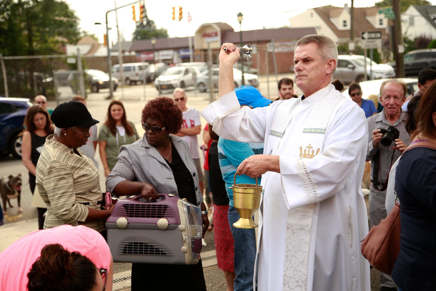 "The Rev. Peter Dugandzic, the pastor of Blessed Sacrament Church, blessed the pets with holy water. ""I get such a joy out of getting to see people with their pets,"" he said."