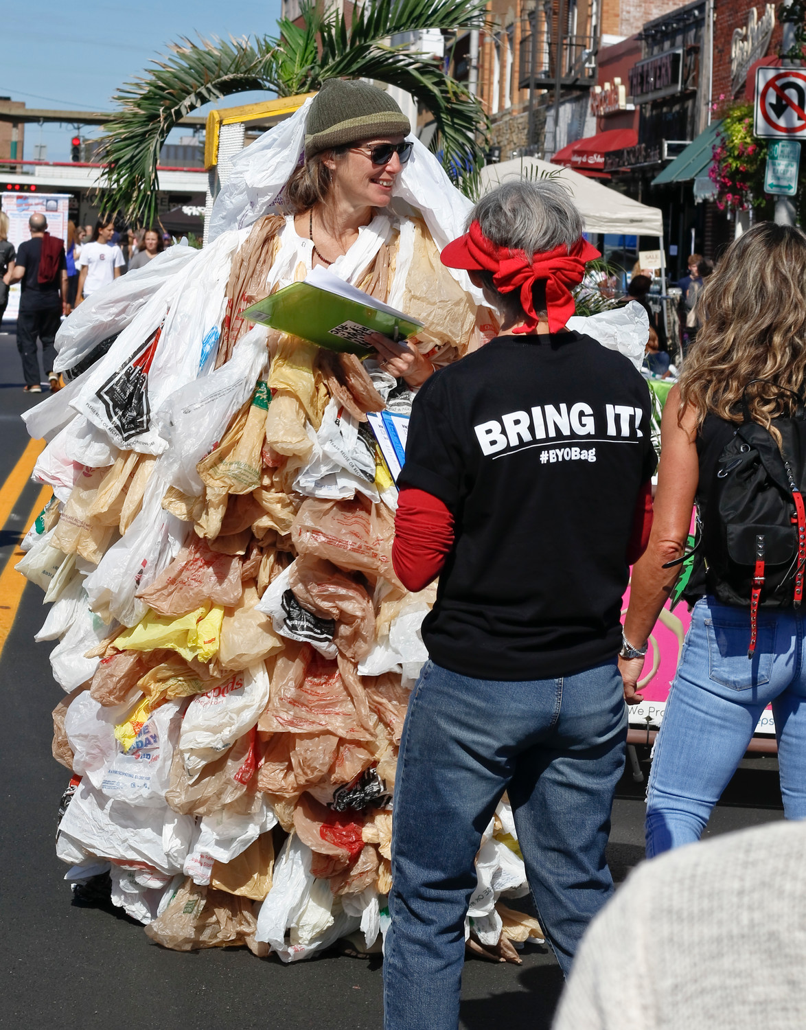"Susan Brockmann, also know as the ""Bag Lady,"" asked festival-goers in Rockville Centre on Sept. 30 to sign a petition urging the village to create a reusable bag ordinance."
