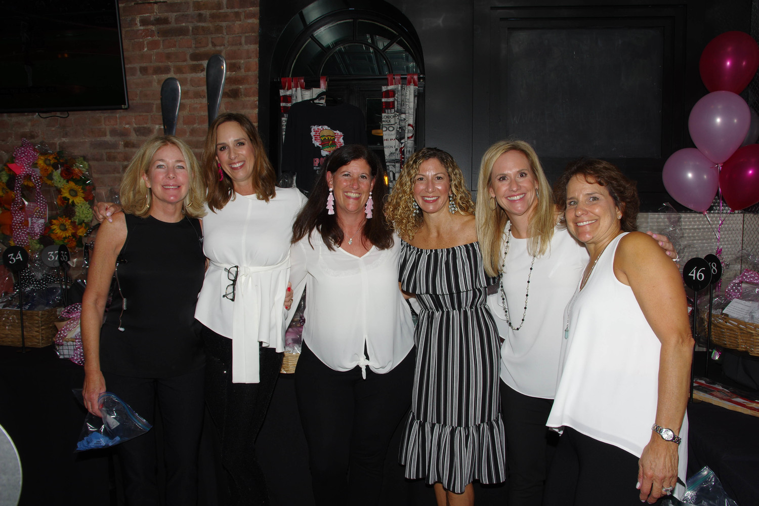 Rockville Centre Breast Co-presidents Peggy McDonald and Erin O'Sullivan, from left, joined fellow coalition members Kathy Baxley, Christina Belling, Laura Altman and Pauline Festa.