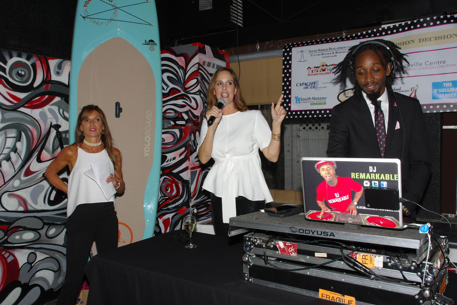 Erin O'Sullivan, center, addressed the crowd alongside Nicole Graziano, as DJ Remarkable spun some tunes.