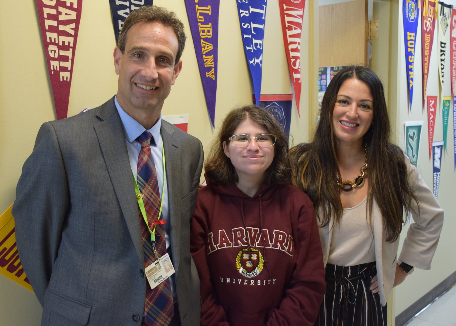 Seaford High School senior Jacqueline Galison, center, joined by Principal Scott Bersin and Assistant Principal Jennifer Bisulca, completed the summer Pre-College Program at Harvard University.