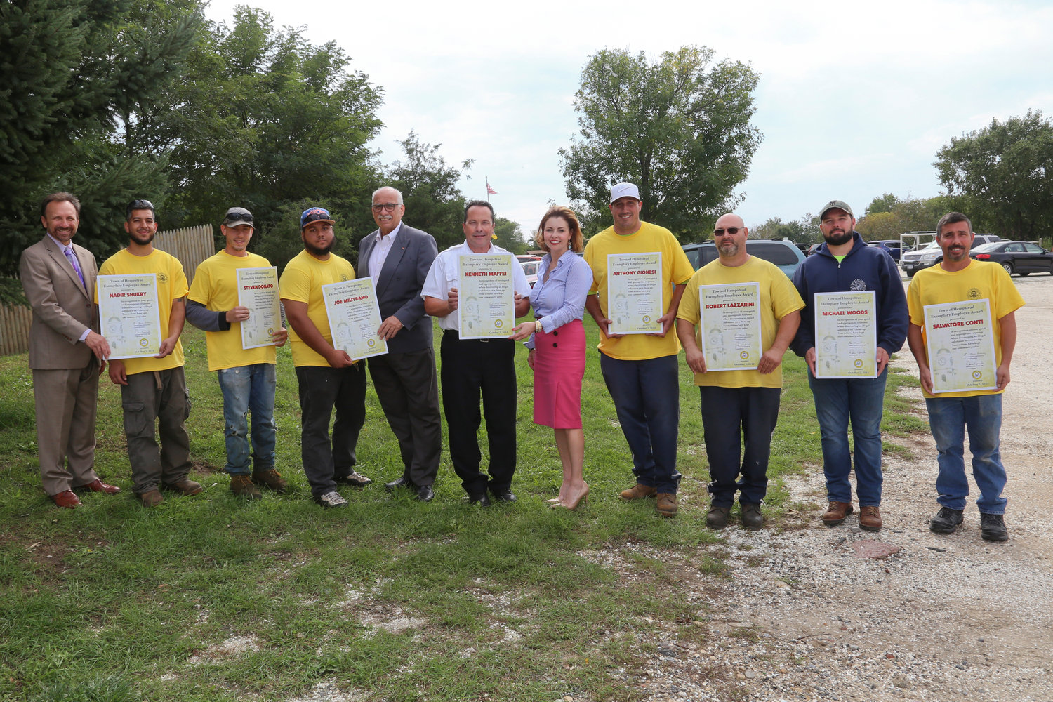 Hempstead Town Councilwoman Erin King Sweeney and Councilman Dennis Dunne presented an award to a Town of Hempstead sanitation inspector and field services crew who found illegal drugs growing at an empt property in Wantagh. From left, CSEA Local President Charles Sellitto, crew members Nadir Shukry, Seven Donato, Joe Militrano, Councilman Dennis Dunne, Sanitation Inspector Kenneth Maffei, Councilwoman Erin King Sweeny, crew members Anthony Gionesi, Robert Lazzarini, Michael Wood and Salvatore Conte.