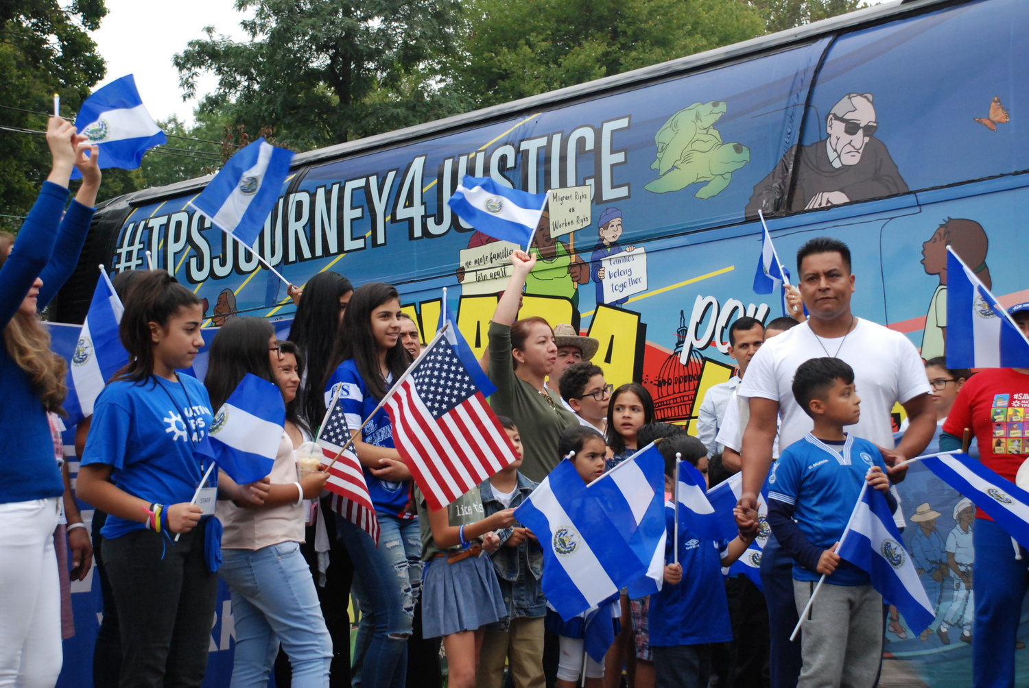 TPS recipients and their supporters came to the Glen Cove Knights of Columbus on Sunday to welcome the Journey for Justice bus, which was on week eight of its 12-week trip around the country.