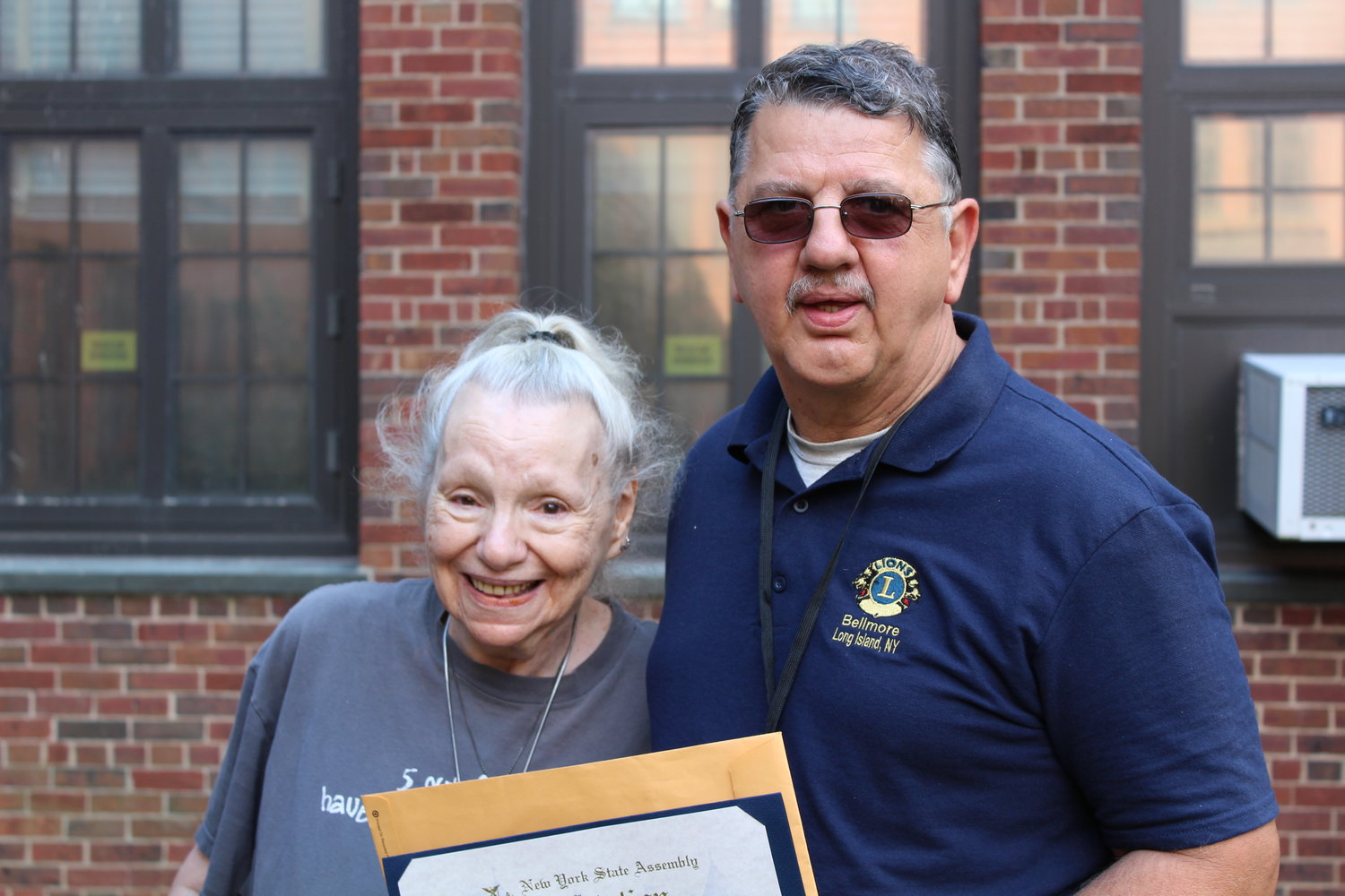Weinman's wife, Myrna, left, and John Scalesi, a friend of the family, attended the ceremony last week.