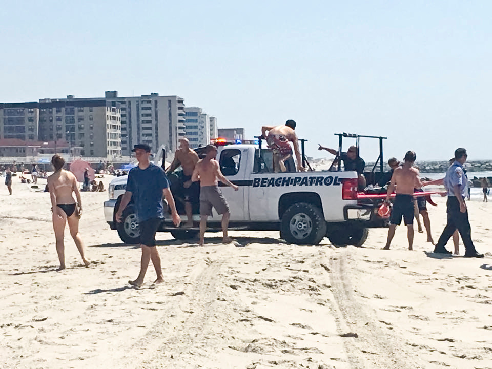 Off-duty Long Beach lifeguards and local surfers pulled swimmers to safety at Riverside Boulevard beach in May.