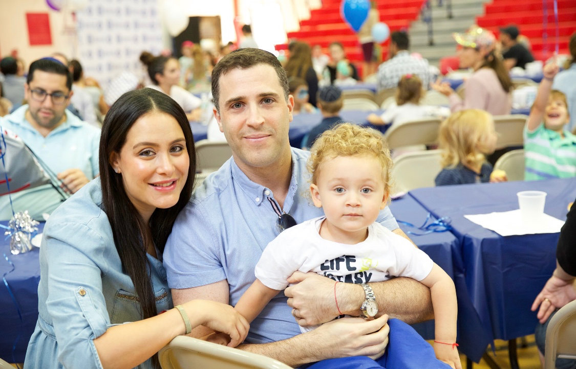 Debbie and Ari Mann, with son, at the HAFTR new family breakfast last month.