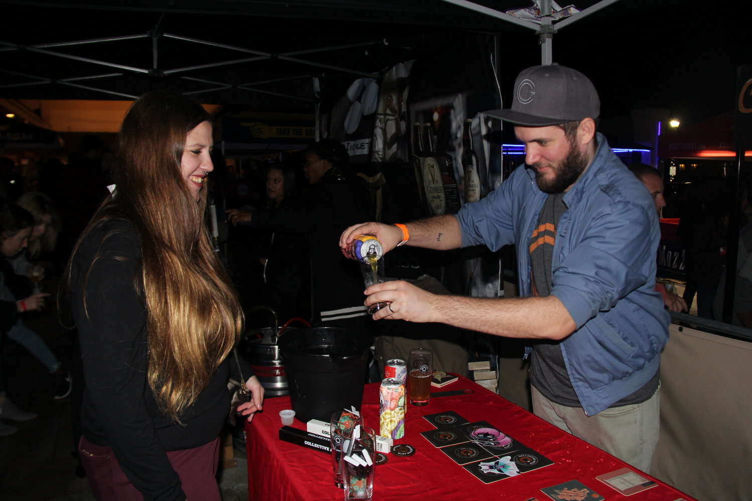 Brian Murrary, of Collective Arts Brewery from Hamilton, Ontario poured a sample of beer for Alisa Peters, from Carle Place.