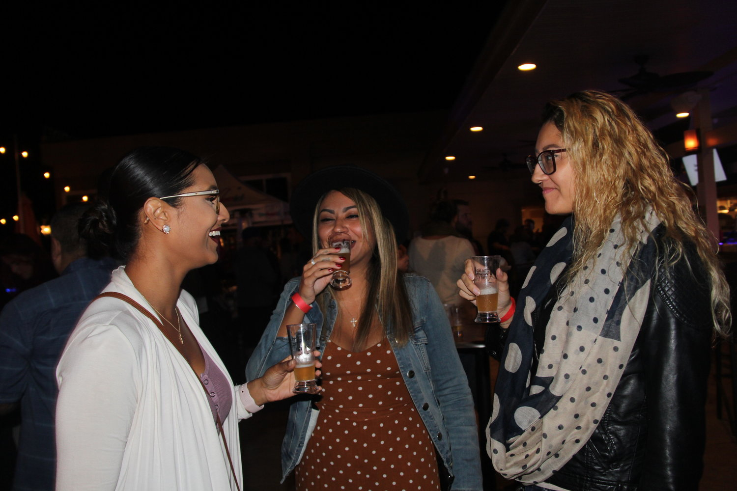 Girlfriends from Baldwin, Shariza Schiemann, left, Jennifer Ramos and Madeline Ramos, right, sampled some of the craft beers during the festival.