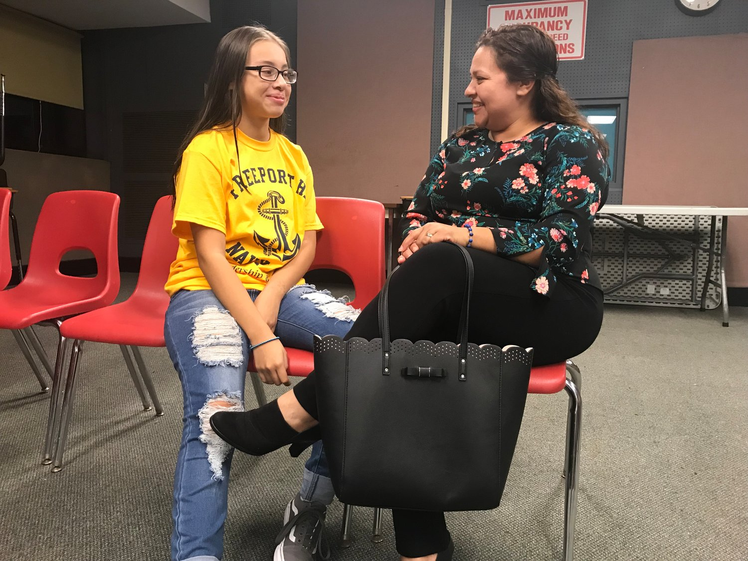 Jessica Flores spoke with her ninth-grade daughter, Katherine Arguesta, during Freeport High School's Hispanic Parent Night on Sept. 27.