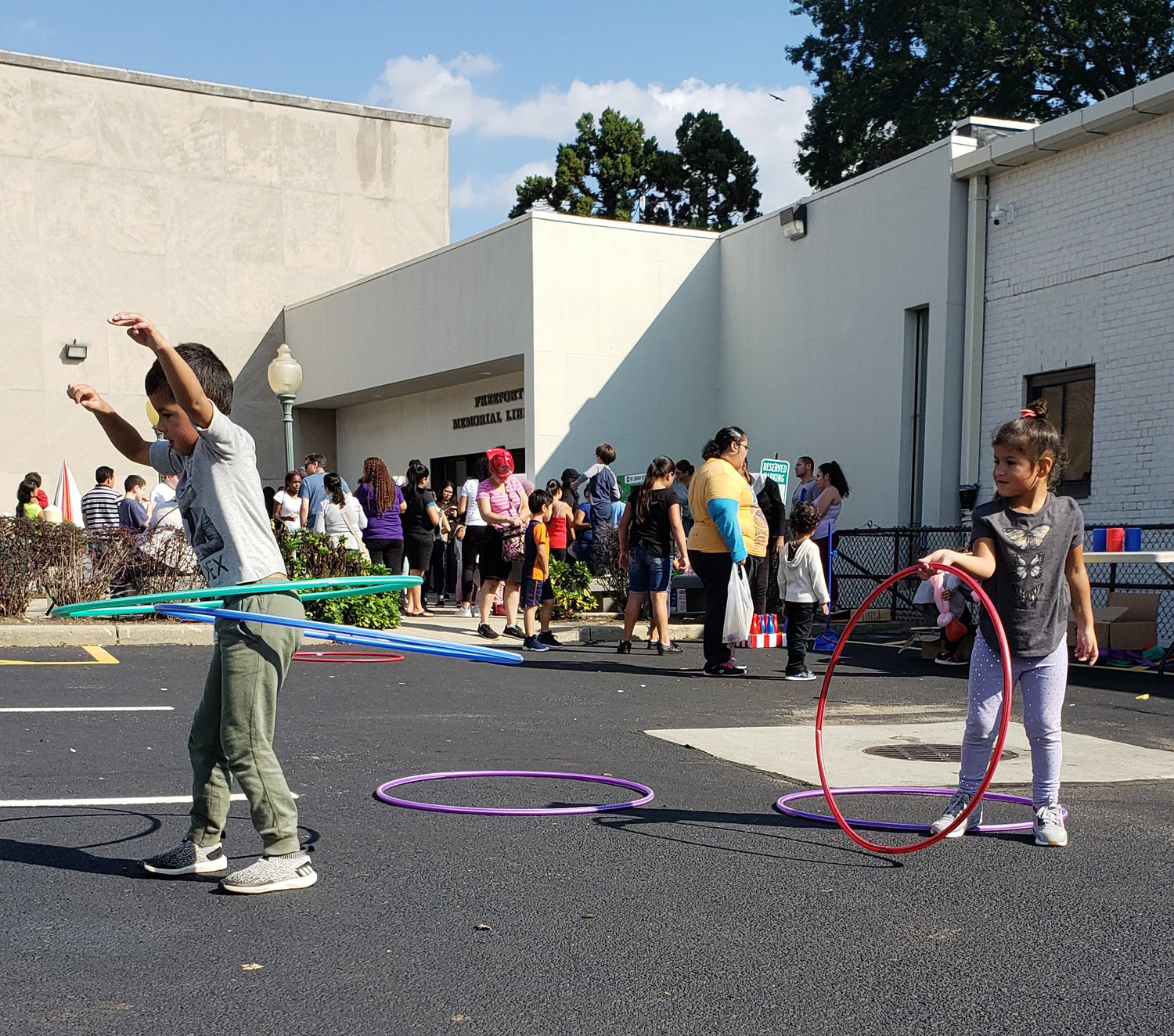 Hector and Liv Santiago, ages 6 and 4, showed off their hula-hoop skills at the Freeport Memorial Library Fall Festival on Sept. 29.