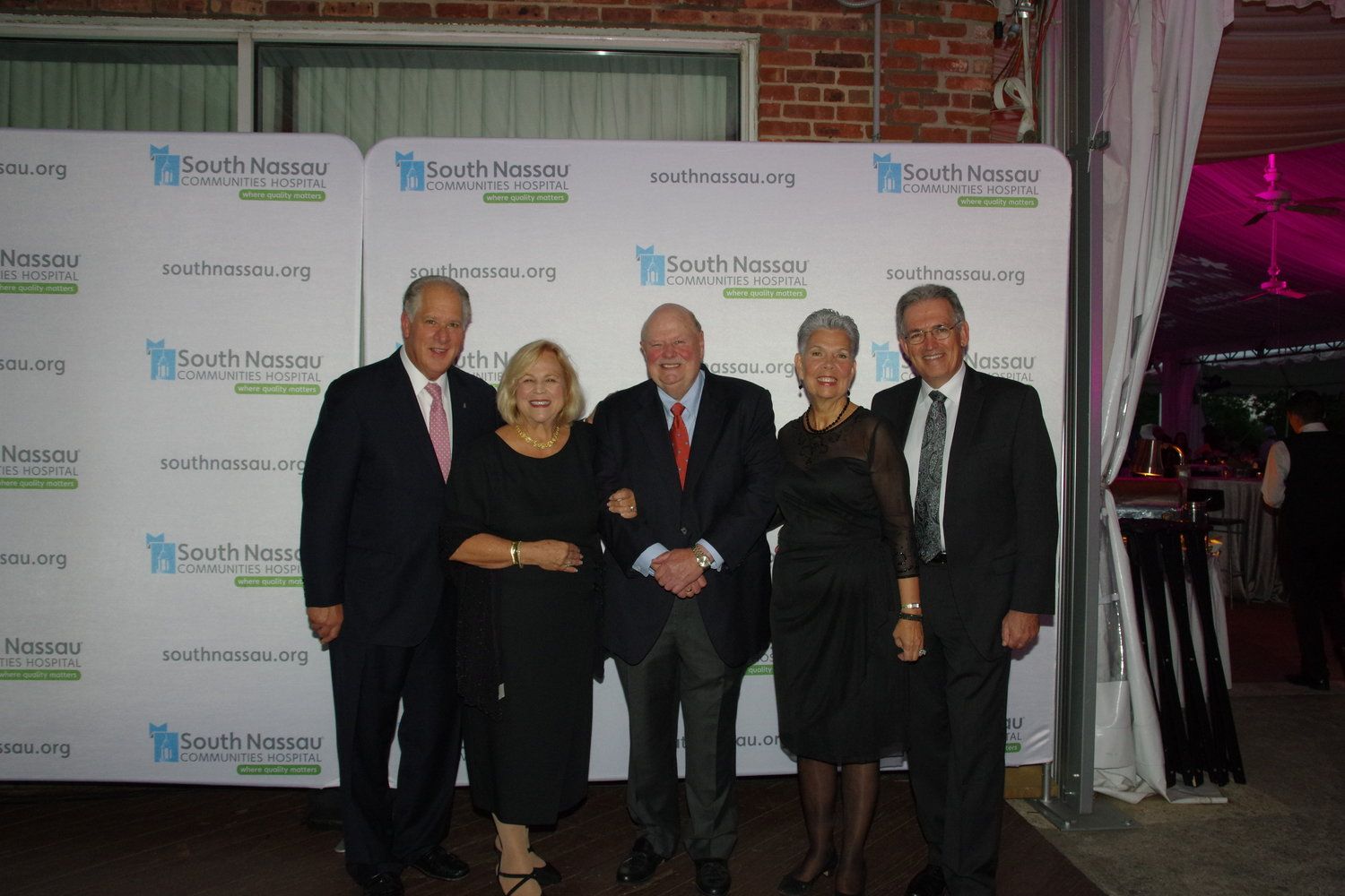 South Nassau Communities Hospital Board Vice Chairman Tony Cancellieri, top left, his wife, Marylou, soirée co-honoree and hospital board Chairman Joseph Fennessy and hospital board member Wayne Lipton with his wife, Karen.