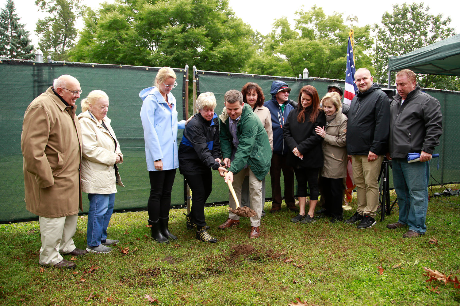 Members of the Steve McDonald Memorial Corporation gathered around Malverne Mayor Patti Ann McDonald and her son, Conor, as they broke ground at Westwood Park for the Steven McDonald Garden of Forgiveness on Oct. 13.
