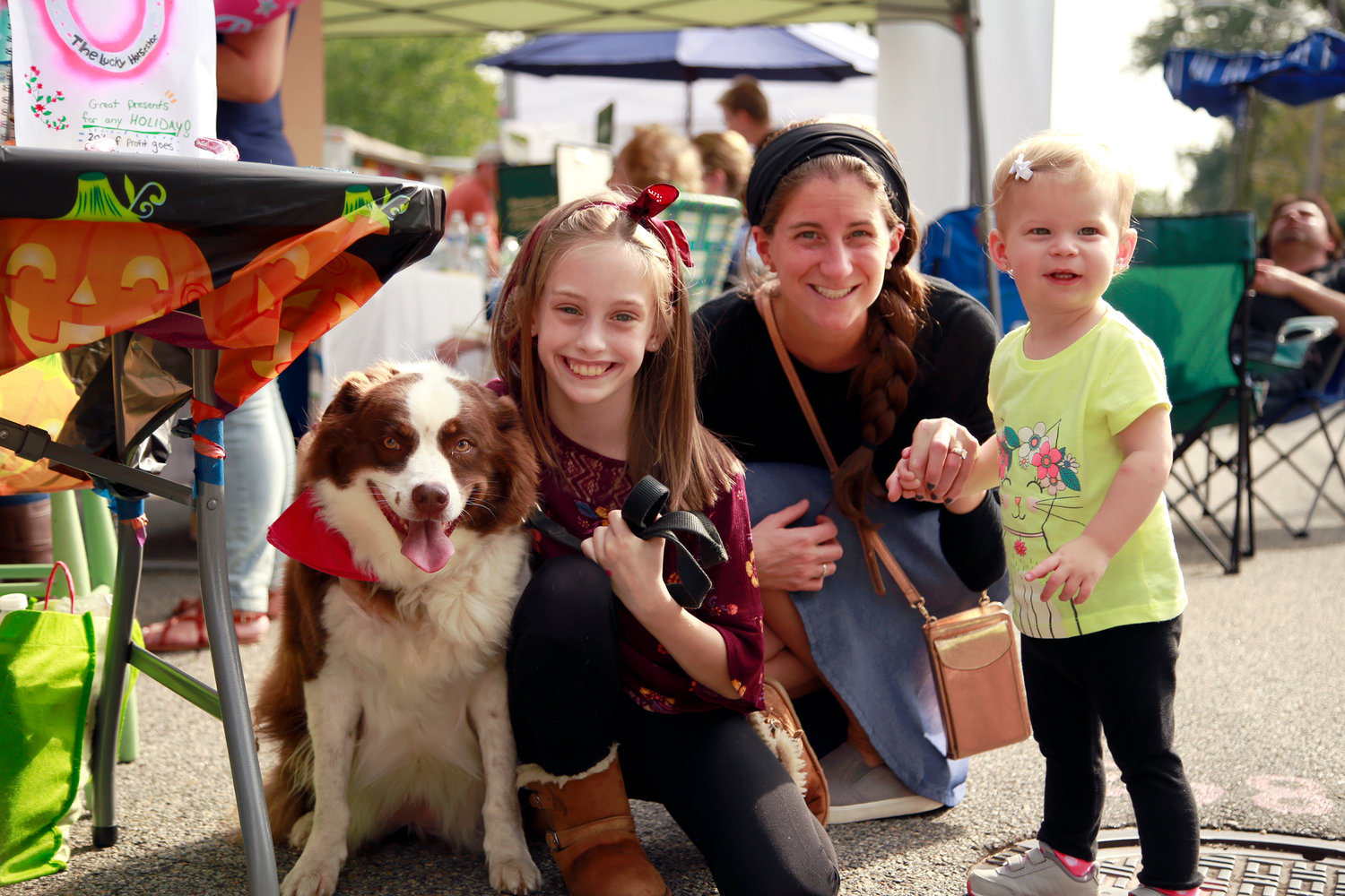Emily Duggan, left — with her Collie mix, Chocolate — were visited by Liz Guttman and her 1- year-old daughter Maayan