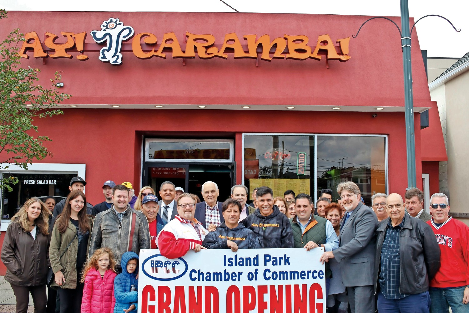 Members of the Island Park Chamber of Commerce, residents and elected officials attended a ribbon cutting for the Ay Carumba restaurant, at 166 Long Beach Road,  on Saturday. The business moved to Island Park from Long Beach last month.