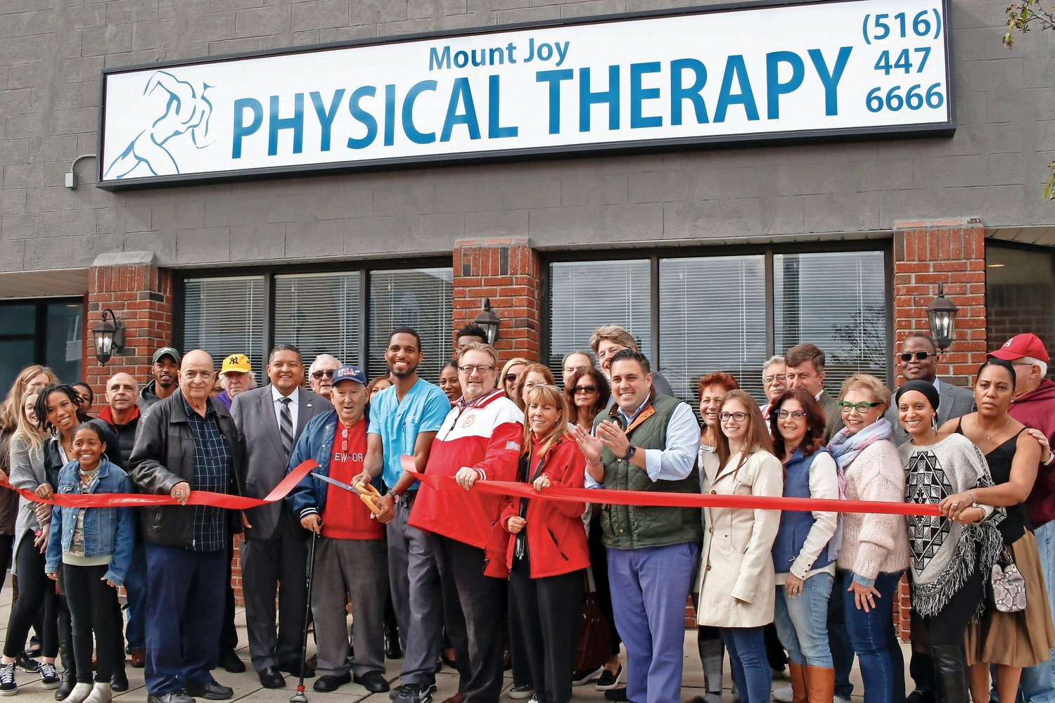 Steve Lubin, center, owns Mount Joy Physical Therapy, which also had a ribbon cutting on Saturday. Lubin was joined by his family and friends and chamber members at the event.