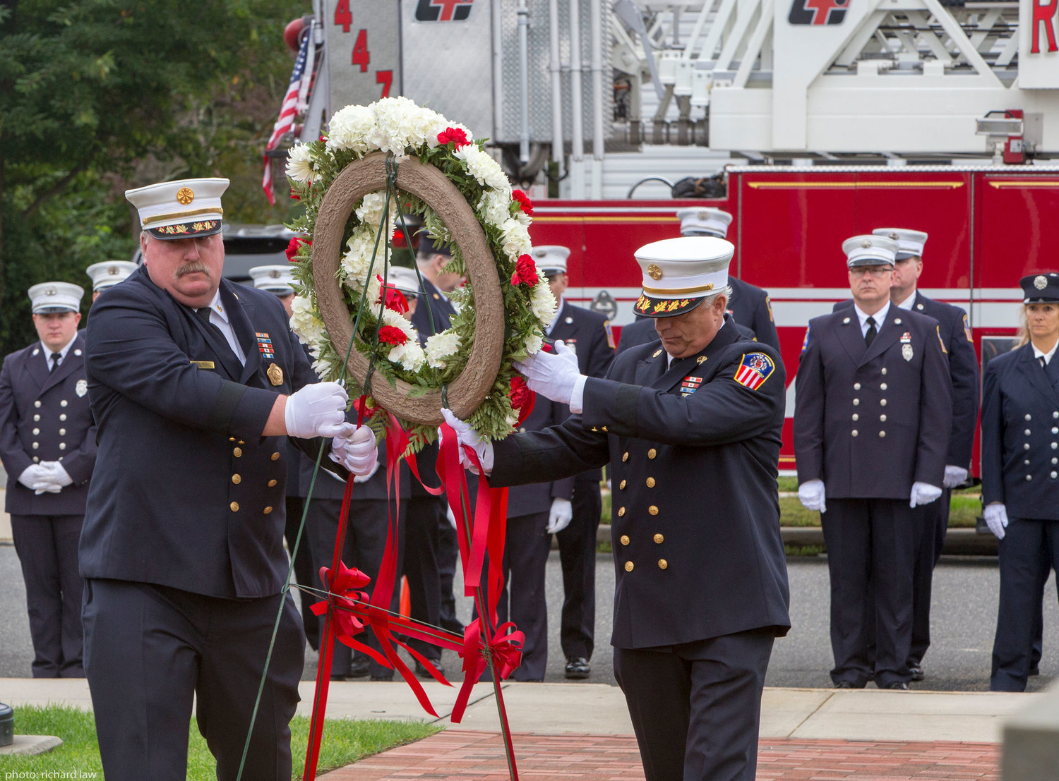 Rockville Centre fire chiefs Eric Burel and James Avondet carried a wreath to the memorial.