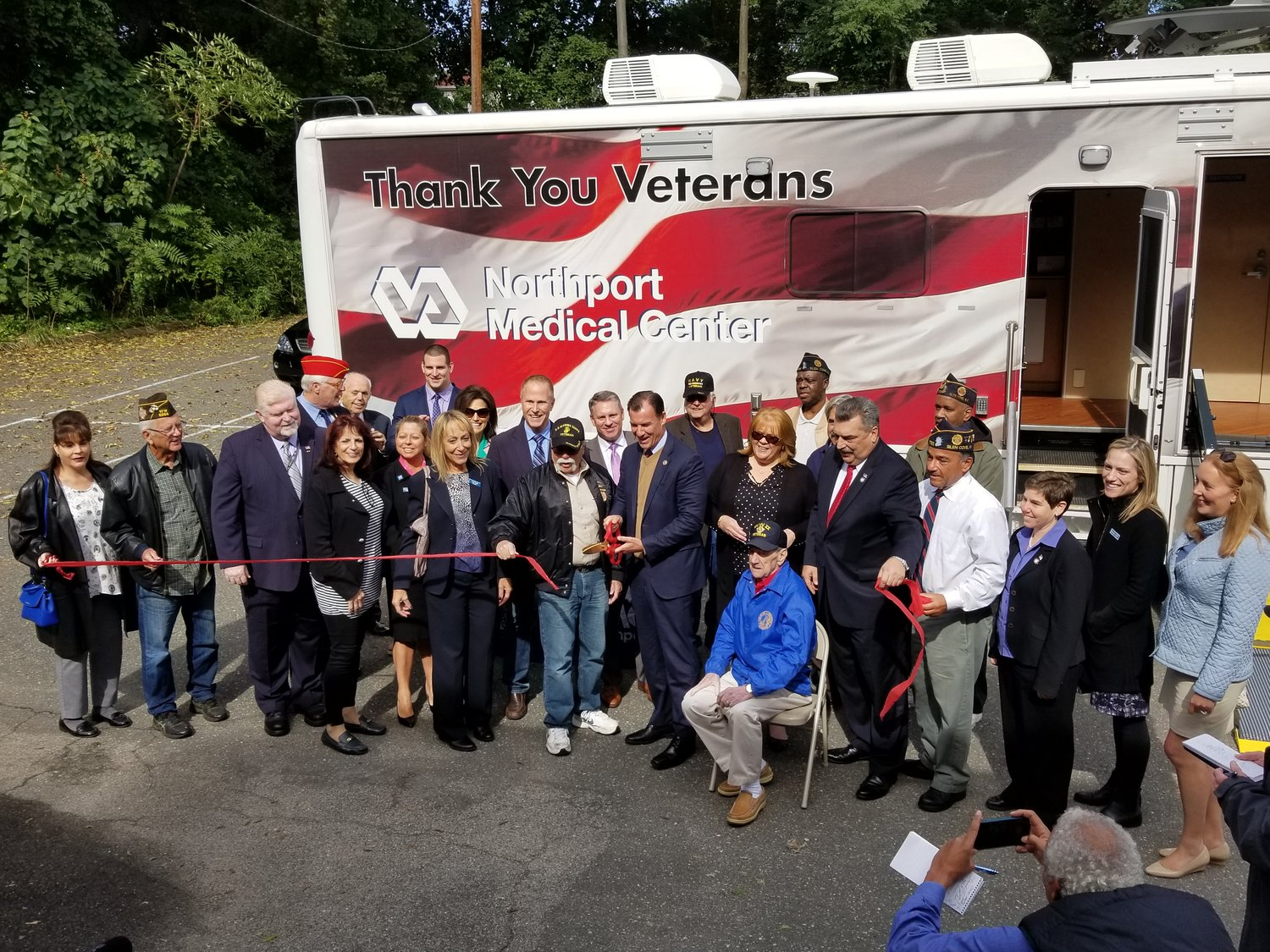Local veterans and dignitaries gathered for the ribbon-cutting of the Northport Veterans Affairs mobile unit, which will be stationed in Glen Cove on Tuesdays.