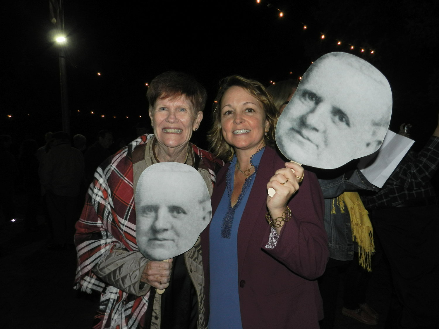 Residents Pat Guy, left, and Kathleen DiResta with fans sporting the face of F.W. Geissenhainer, Sea Cliff's first president.