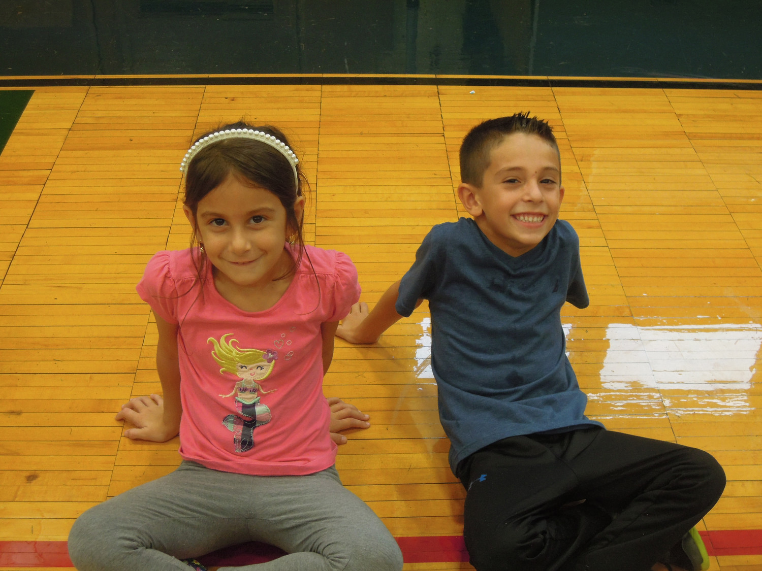First graders Jenna DiTooia, left,  and Antonio Manessis said they enjoyed running at home. Next year, the program will expand to include all teh schools in the Wantagh School Disrtrict.