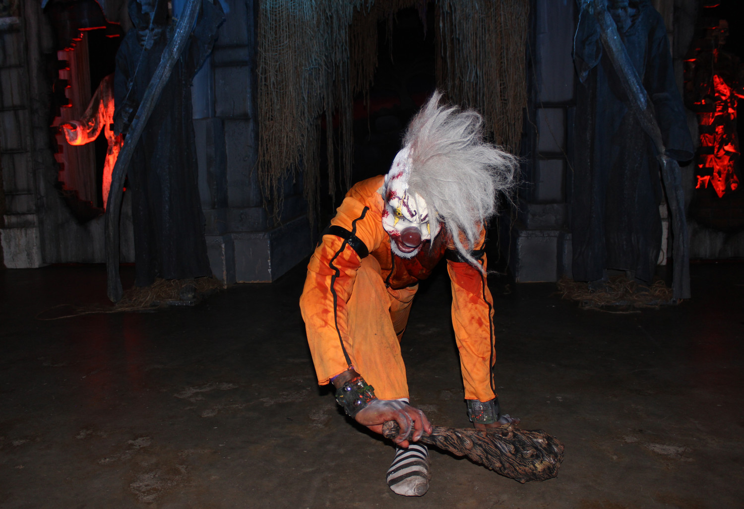 A scary clown crept outside the entrance of Blood Manor to shock guests waiting on line.