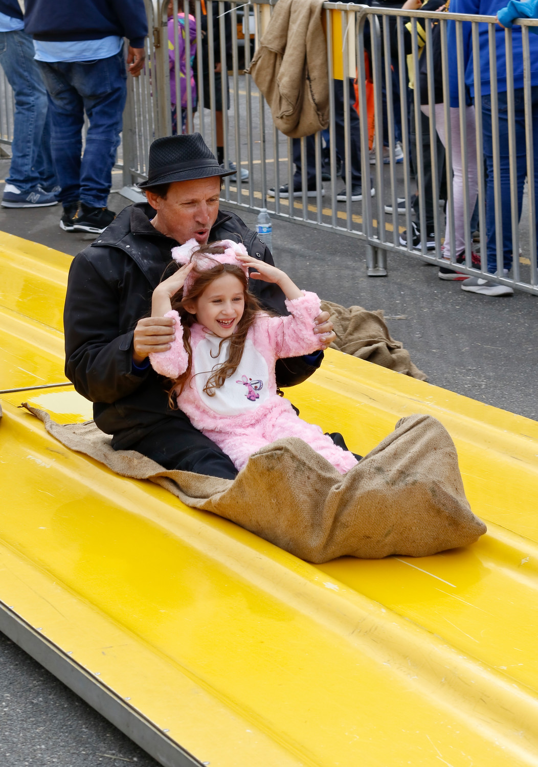 Sophie Rusgo, 6, dressed as the Energizer Bunny and flew down the slide with her father, Steven.