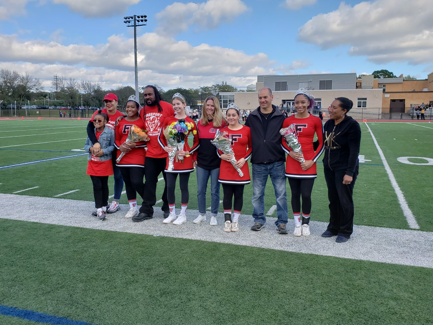 At Halftime of last Saturday's Homecoming win over East Meadow, four senior cheerleaders were recognized, and stood with family members.