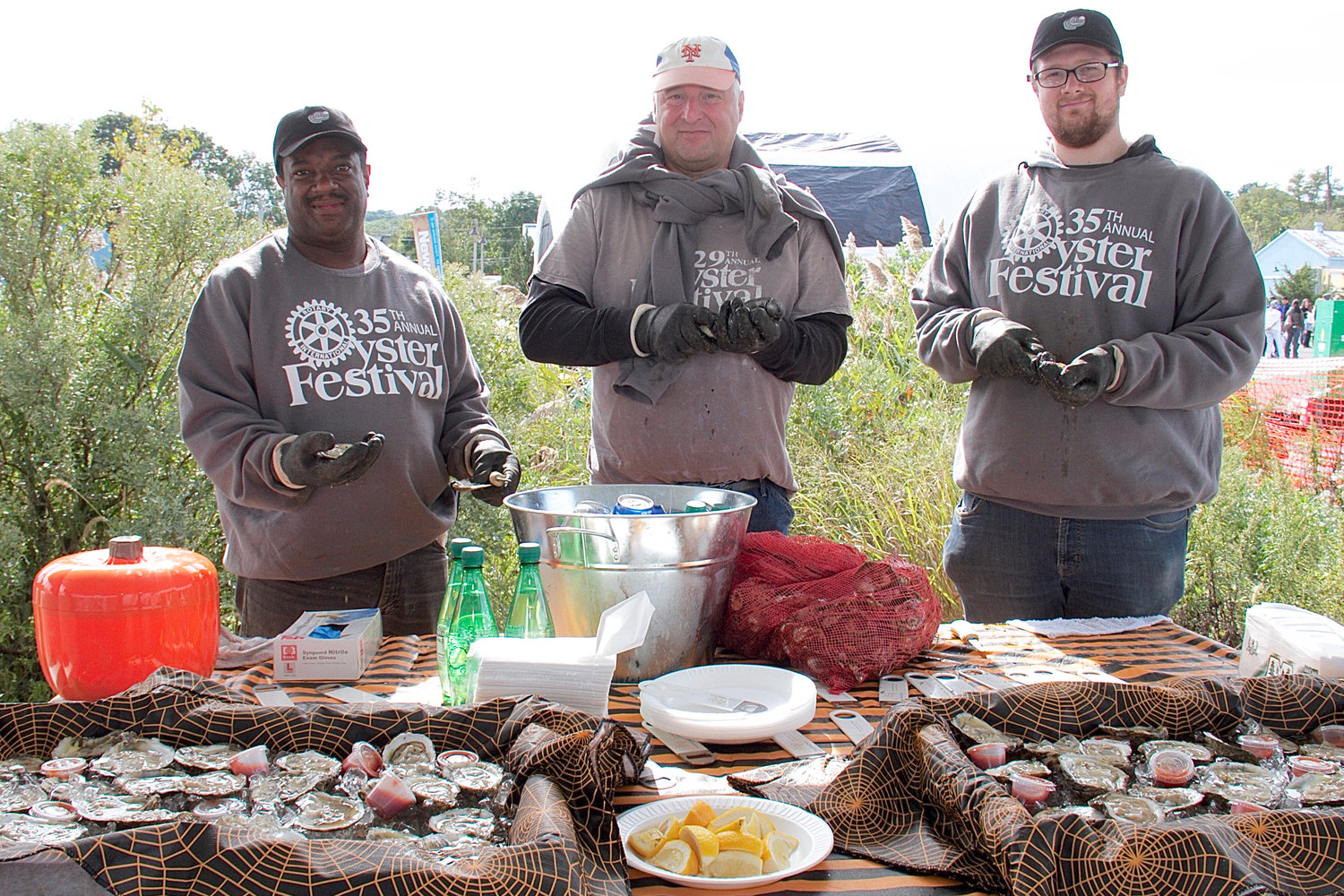 Darrin Banks, Darryl Dowers and Ted Davidson shucked oysters  at the festival.