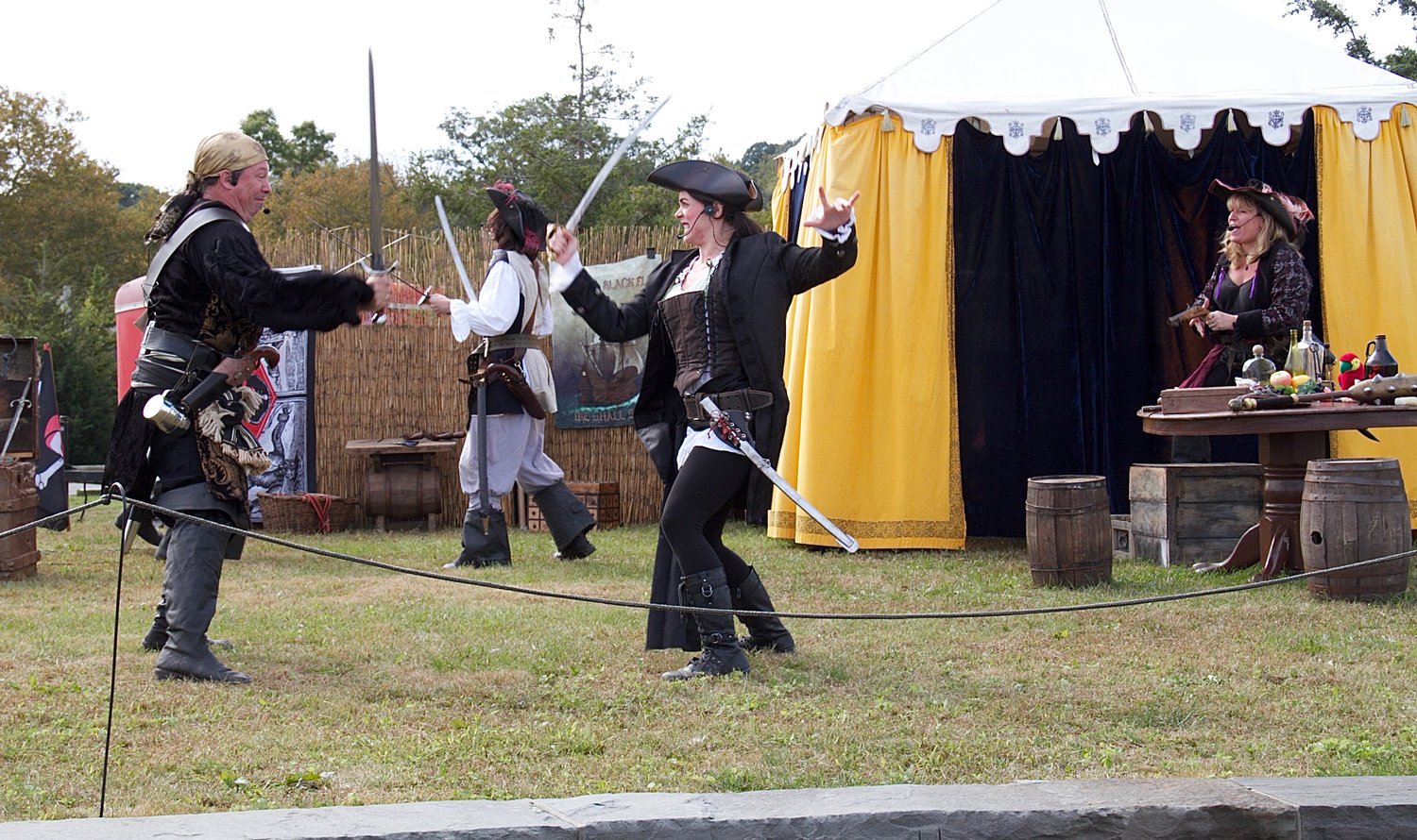 Pirates entertained crowds with a lively sword fight.