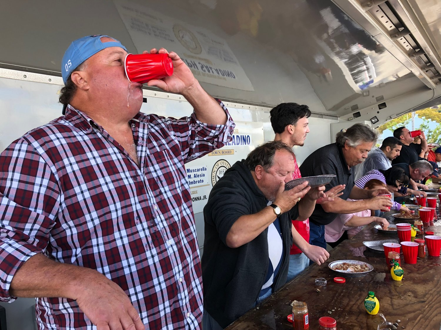 Shawn Leonard, of Cold Spring Harbor, slurped down a cup of briny oyster alongside other contestants at the 2018 Oyster Festival oyster eating contest.