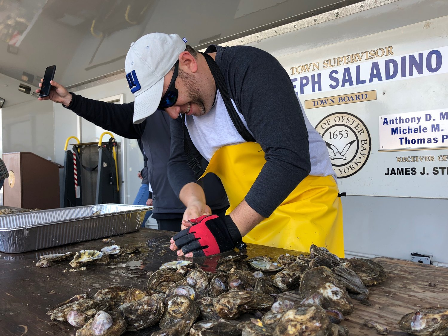 "Brad Launer, of Oyster Bay, endured a ""shuck-off"" for second place during the oyster shucking contest on Saturday."