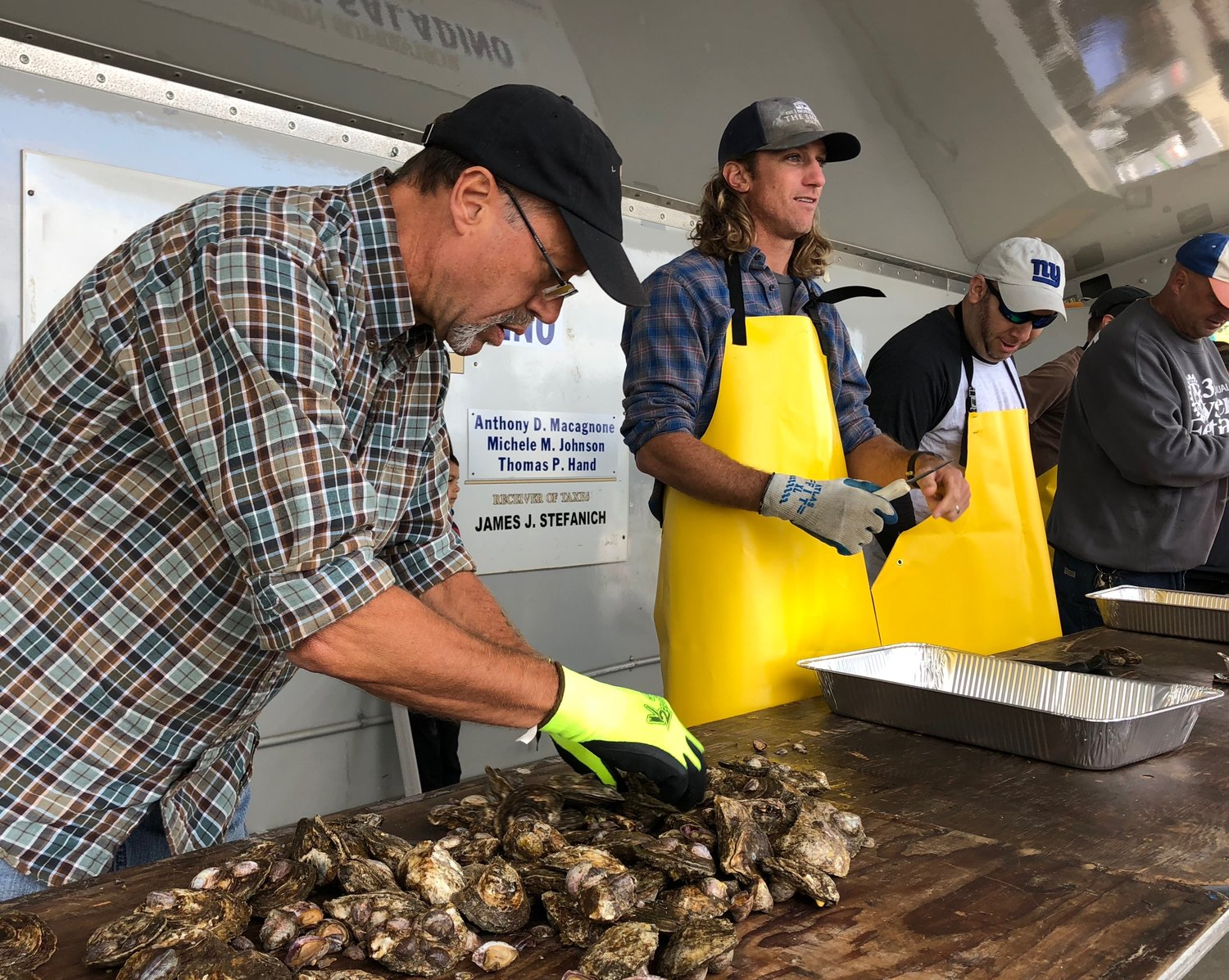 Four shuckers took part in the 2018 oyster shucking contest, coming from as close as Glen Cove to as far as Mattituck.