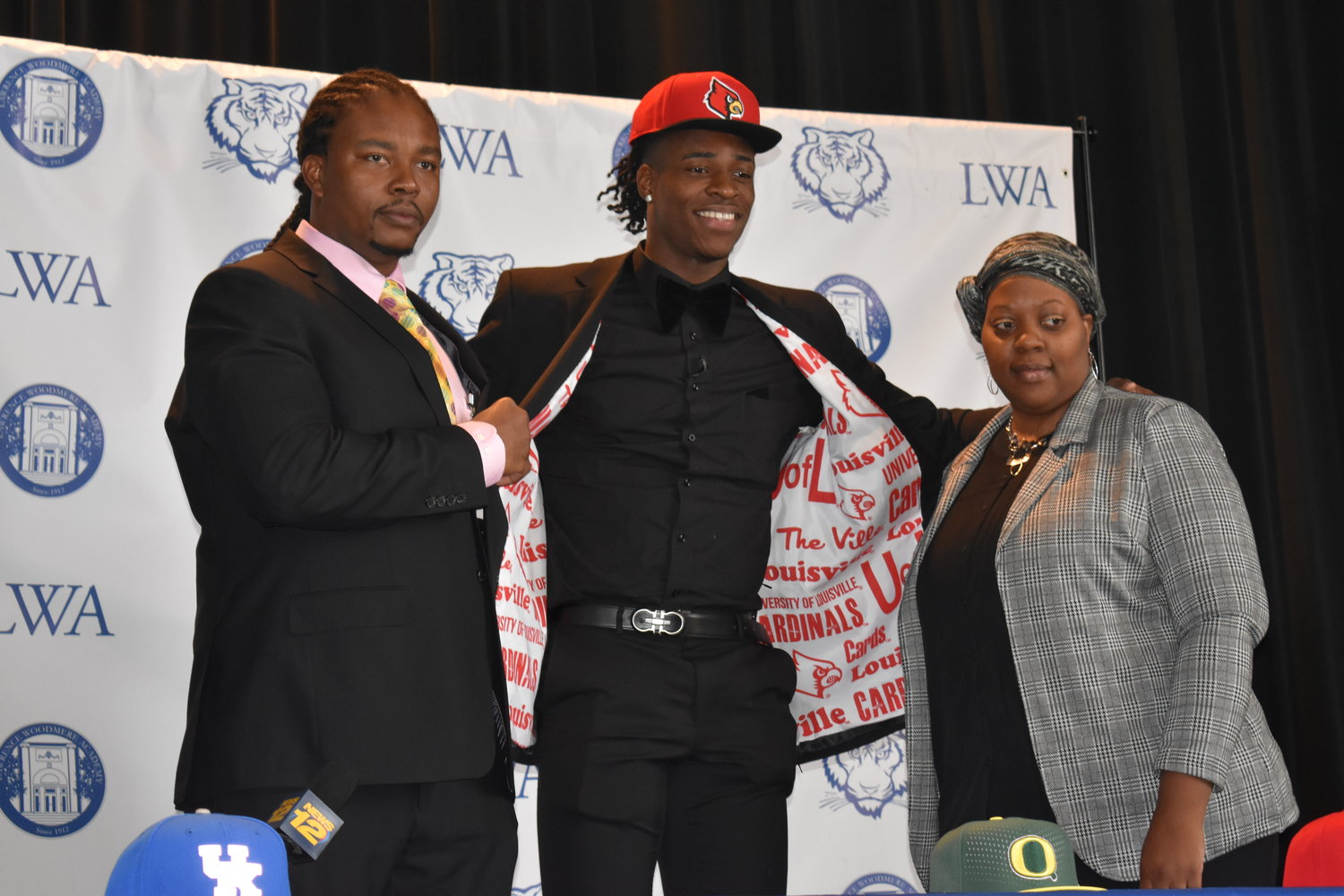 Lawrence Woodmere Academy senior Aidan Igiehon announced his decision to play for the Louisville Cardinals next year with his Uncle Solomon Igiehon and Aunt Zenovia Igiehon.