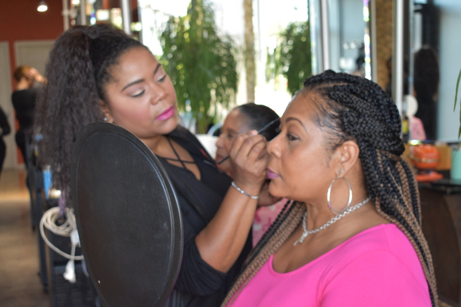 Consuella Jeune, left, gives breast cancer survivor Dawn Walker a makeover.