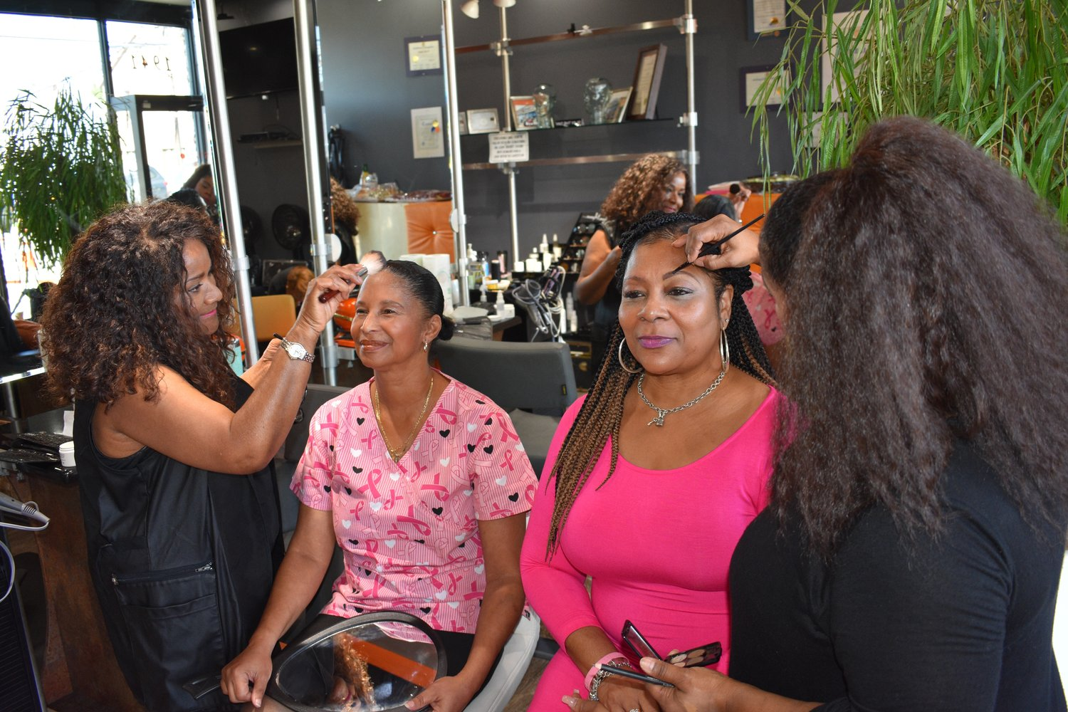 Makeup stylists Vera Moore, left, and Jeune helped beautify Bernice Smith and Walker.