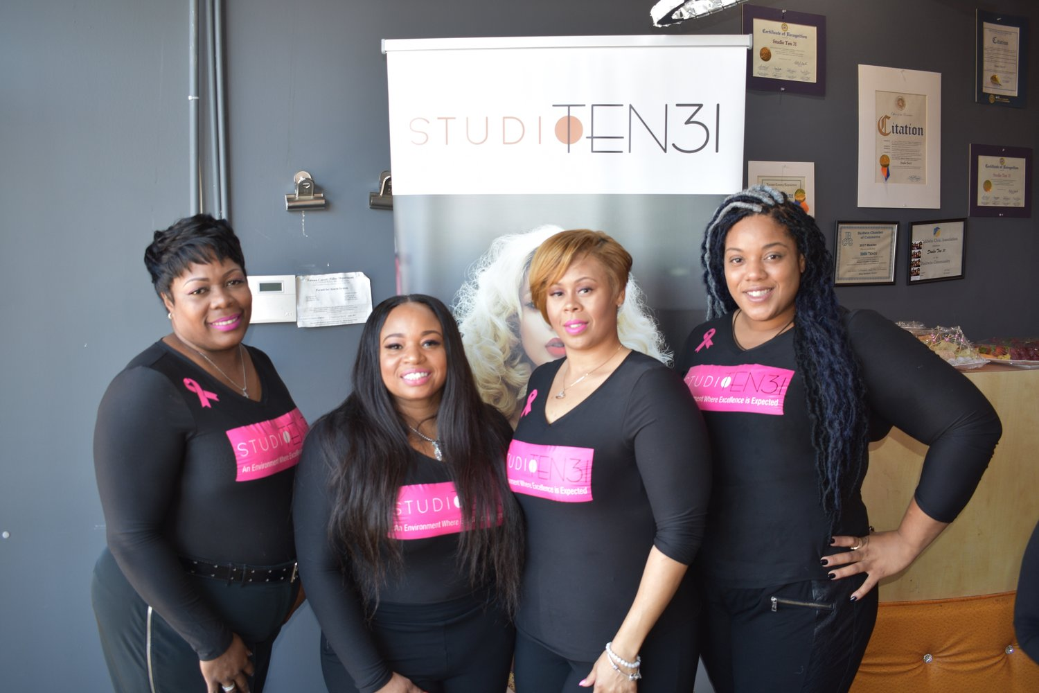 The hair stylists of Studio Ten31 in Baldwin provided a day of beauty for breast cancer survivors. Past clients of the salon have died from the disease.