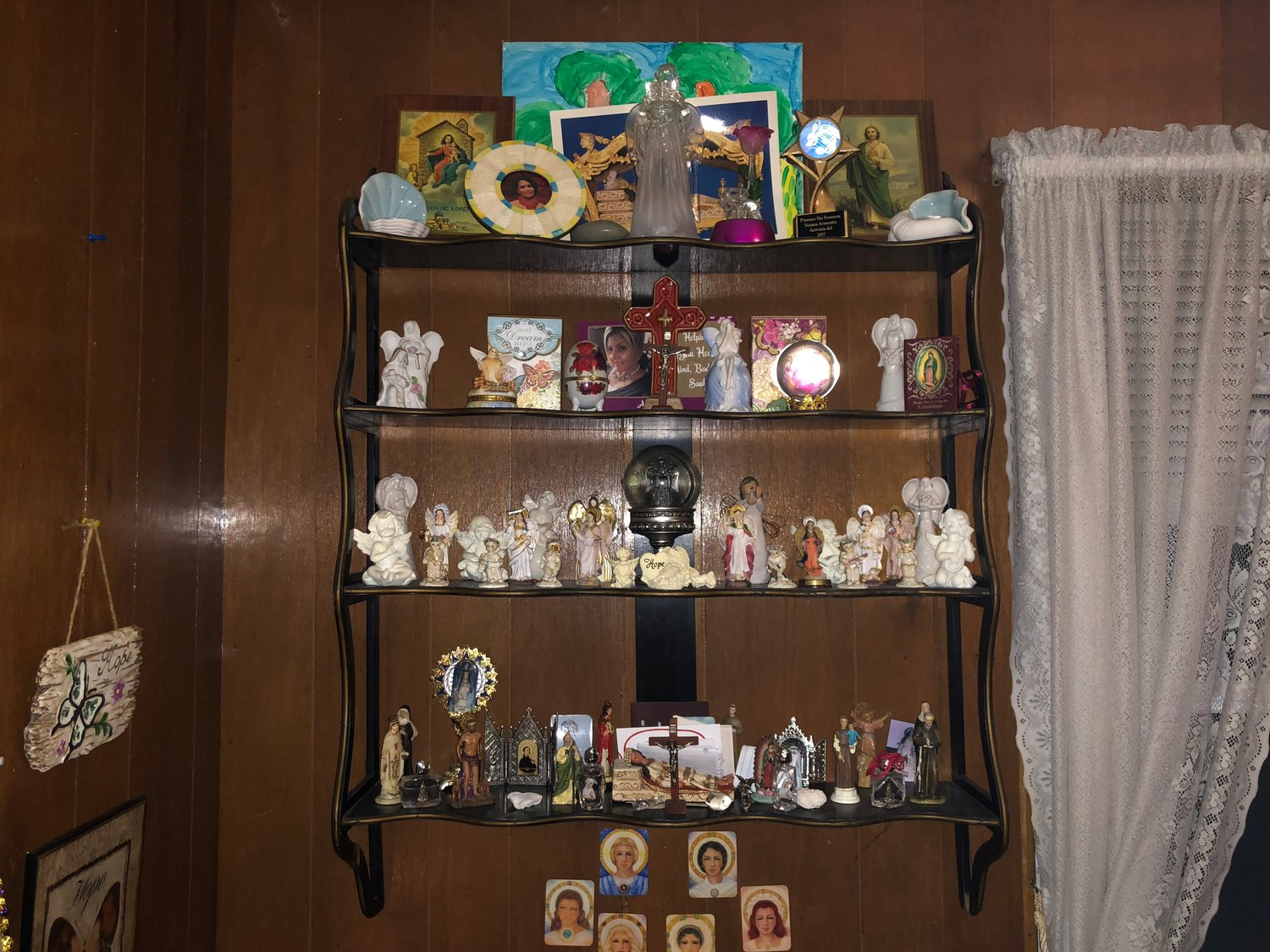"Armentia's collection of spiritual figurines gazes down over her ""healing room."""
