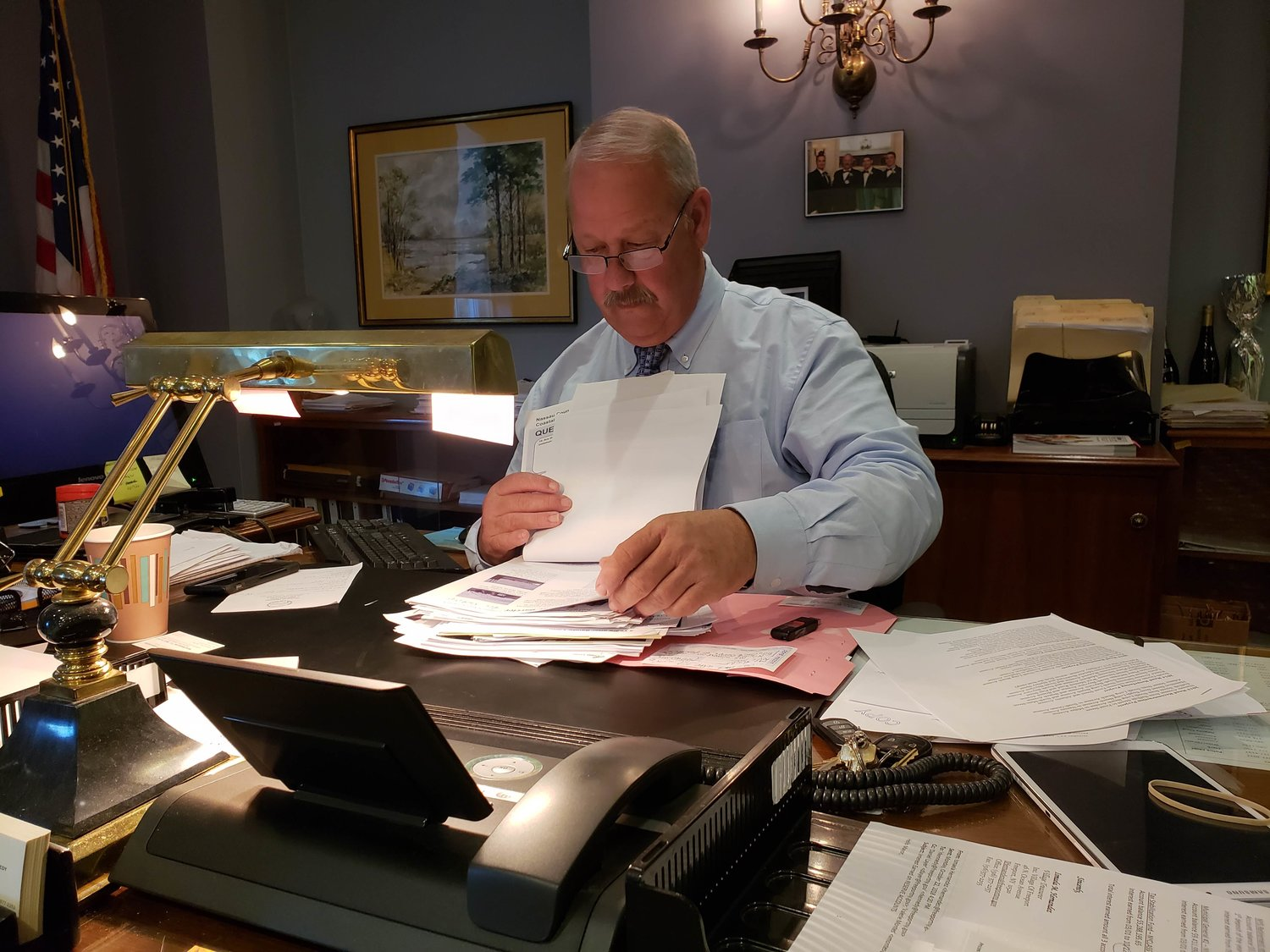 Freeport Mayor Robert Kennedy reviewed paperwork detailing current and upcoming storm resiliency projects in the village.
