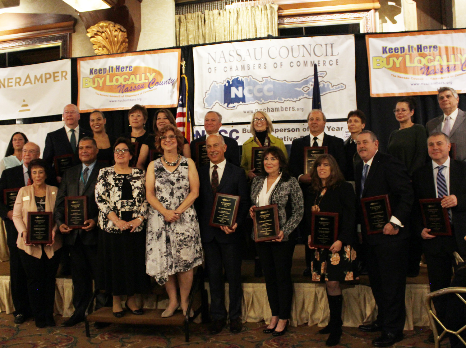 Nassau county Business leaders — including Rosemary Basmajian, fifth from left in top row — were honored on Oct. 19 at the Crest Hollow Country Club in Westbury.