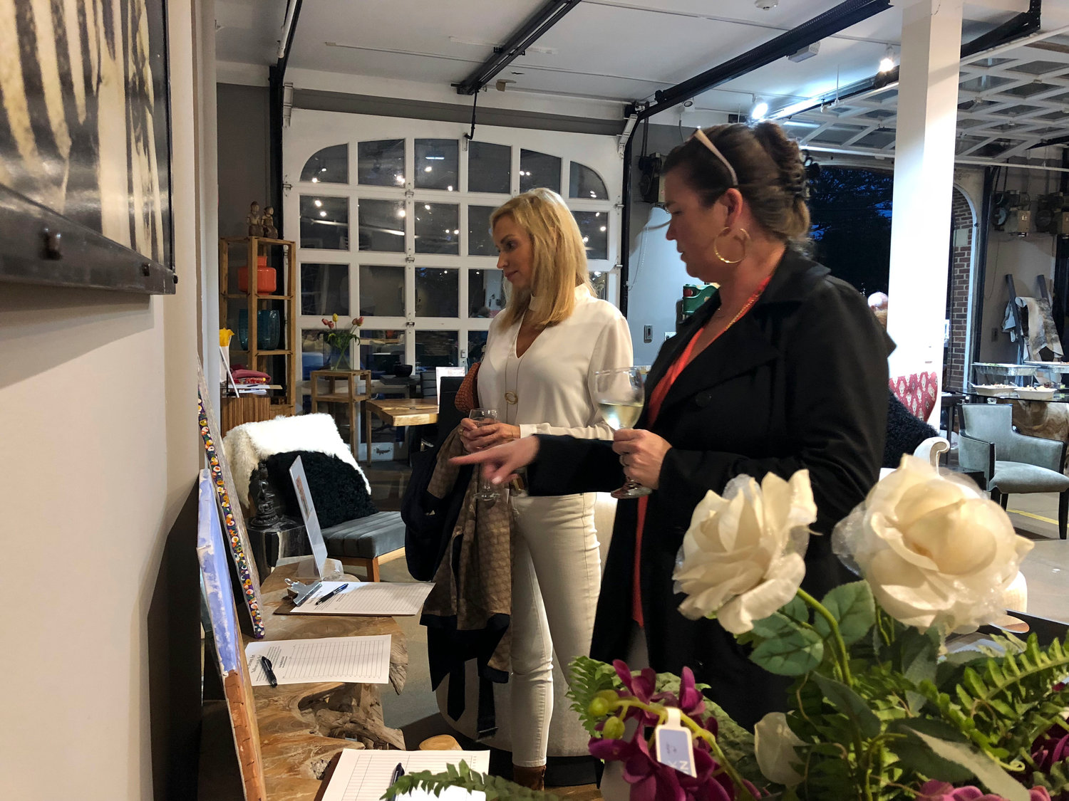 Branch realtors Christina Volz and Molly Deegan, of Sea Cliff, observed the fine art pieces up for grabs at the auction.