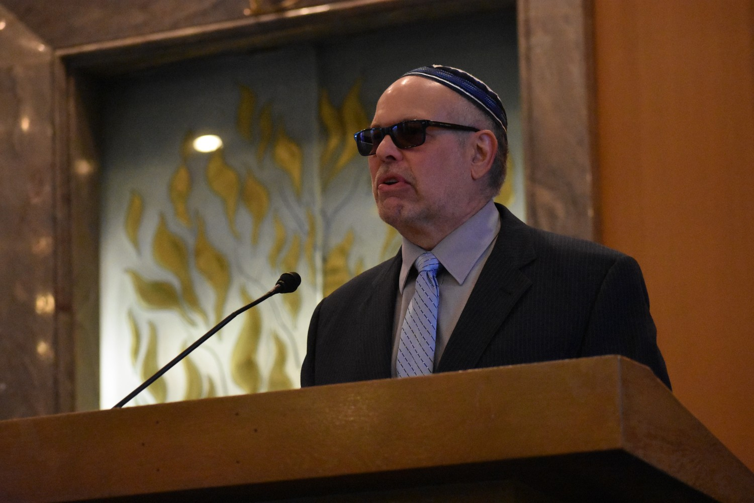 Rabbi Marc Gruber, of Central Synagogue-Beth Emeth in Rockville Centre, pictured at a vigil after the shooting at Marjory Stoneman Douglas High School in Parkland, Fla. in February, reacted to the latest mass shooting on Saturday at a Pittsburgh synagogue.