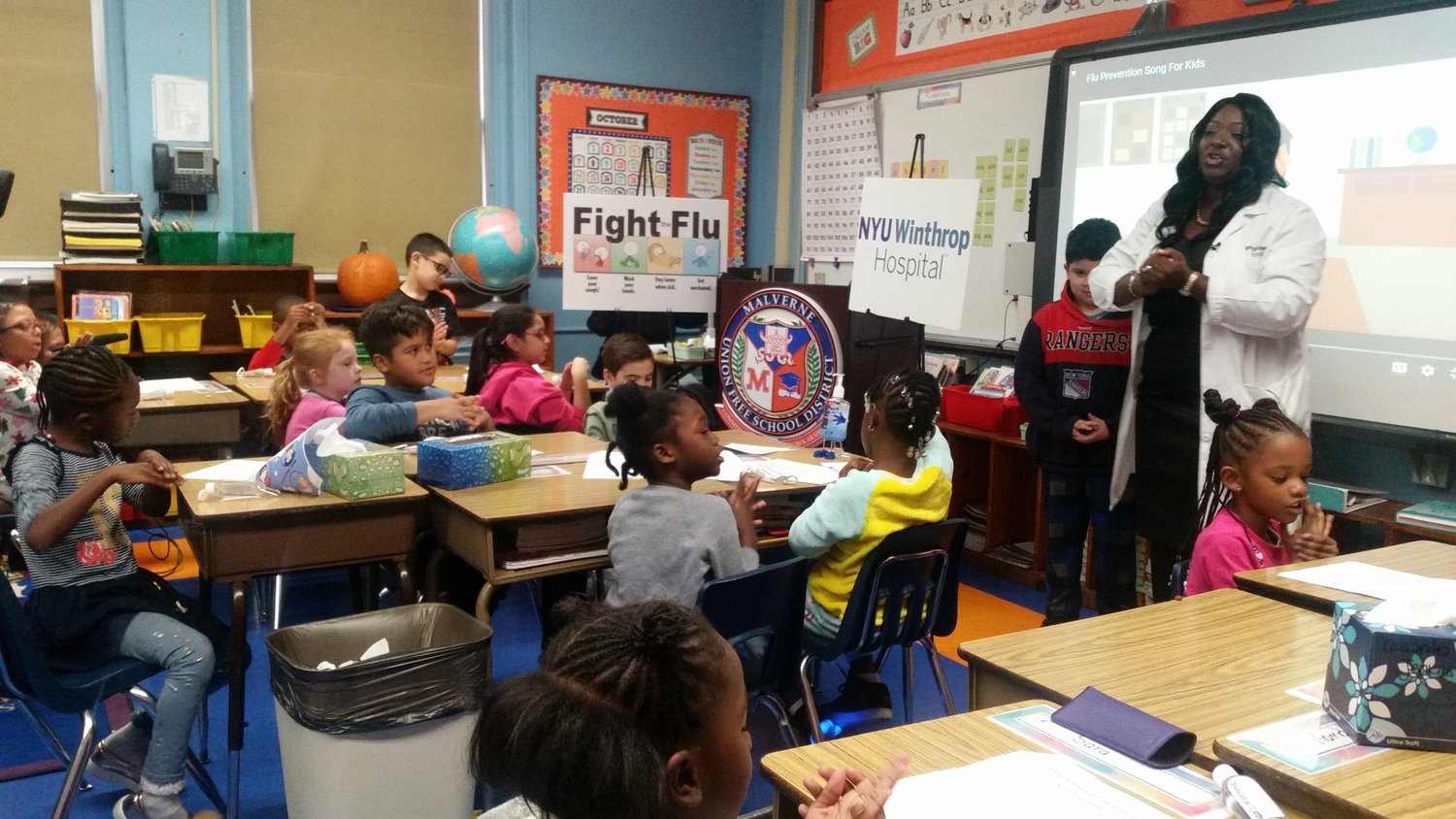 Dr. Ranekka Dean, director of infection prevention at NYU Winthrop Hospital, met with students at Maurice W. Downing Primary School on Oct. 25 to discuss flu prevention.
