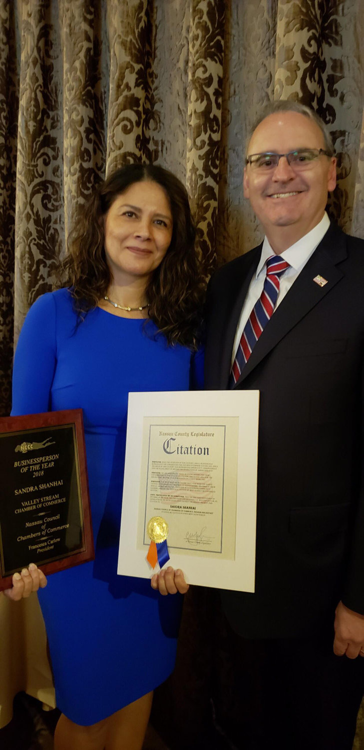 Sandra Shanhai, the principal of Valley Stream Christian Academy, was named the Valley Stream Businessperson of the Year at the Nassau Council of Chambers of Commerce breakfast on Oct. 19. She is pictured with County Legislator Bill Gaylor.