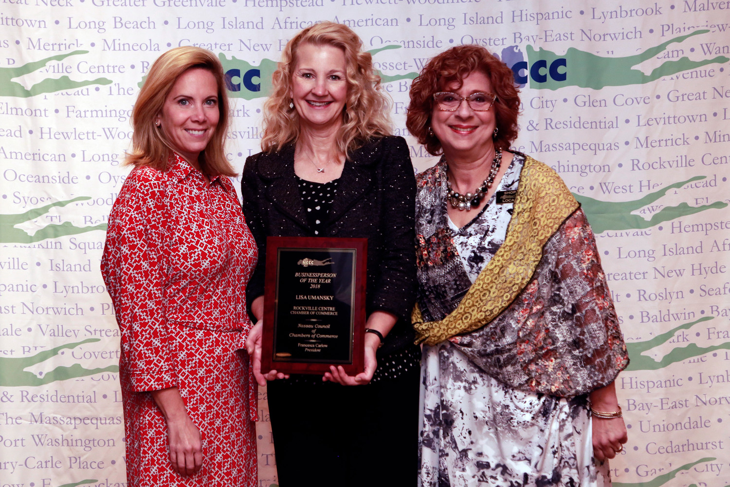 Lisa Umansky, owner of Polka Dot Pound Cake, center, was named Rockville Centre's Businessperson of the Year. She was joined by Hempstead Town Supervisor Laura Gillen and Francesca Carlow, president of the Nassau Council of Chambers of Commerce.