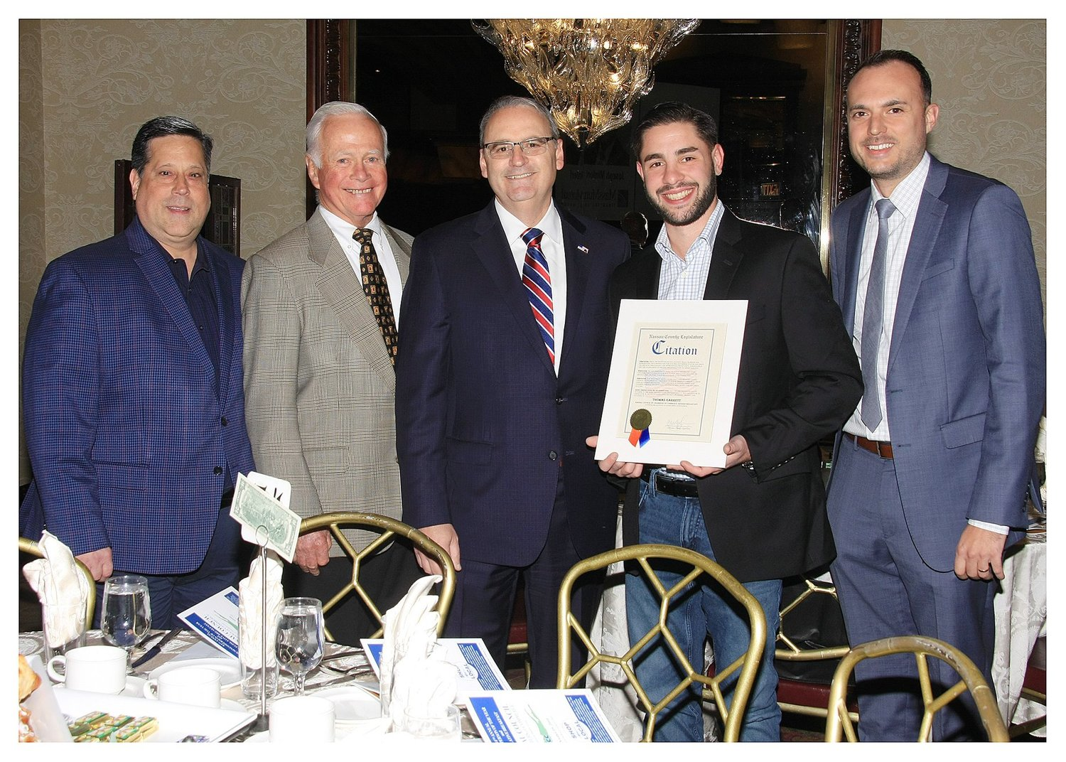 Tom Garrett, second from right, was named one of the Business People of the Year at the Nassau Council of Chambers of Commerce breakfast on Oct. 19. Above, Garrett with Lynbrook Chamber of Commerce Vice President Stephen Wangel, far left, Chamber member Harold Reese, Nassau County Legislator William Gaylor and Chamber Marketing Director Mike Davies.