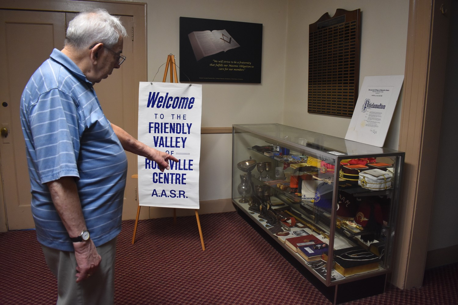 Bob Stack, a freemason for more than 50 years, showed off the display cases he recently filled to preserve the history of fellow members of freemasonry.