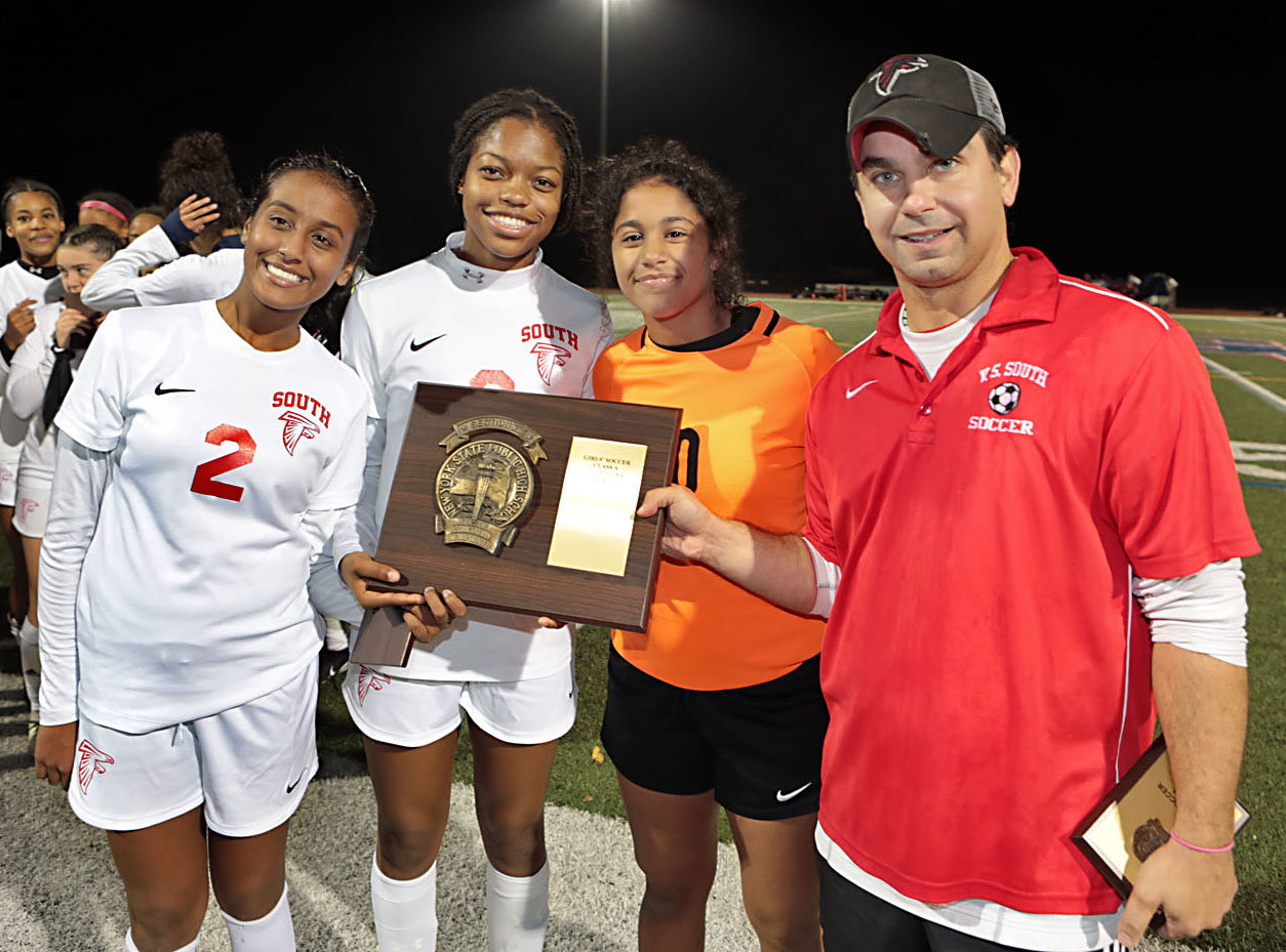 Valley Stream South's Yasmin Voytelmgum, Lindsey Smith and Natalie Peralta, along with coach Demetri Adrahtas, had a firm grip on the county championship plaque after beating MacArthur 2-0.
