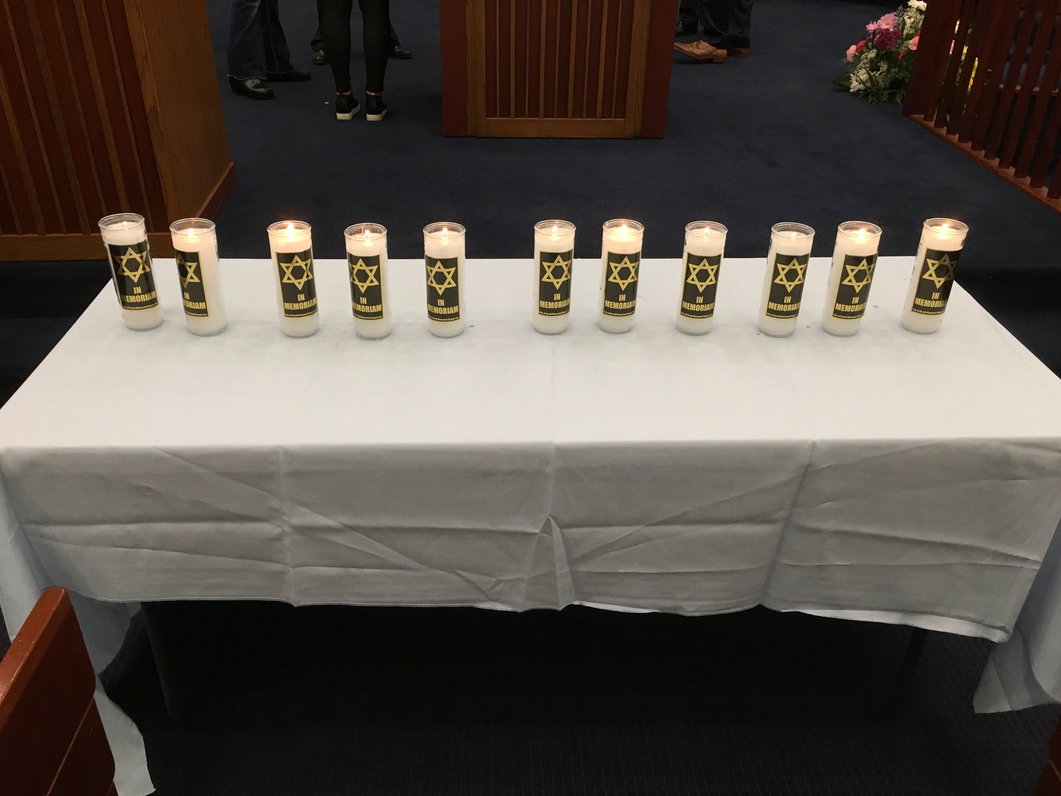 Eleven candles — one for each victim — were lit at the Merrick Jewish Centre on Monday night, as the community mourned the Pittsburgh victims.