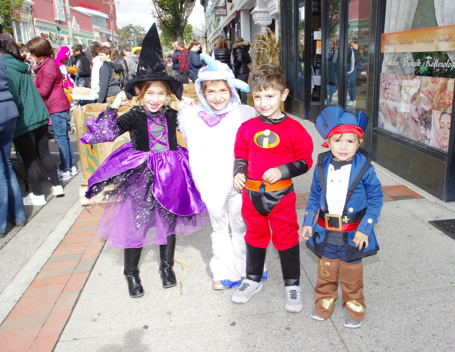 Atlantic Avenue in Lynbrook was a spook-tacular destination last Sunday, as the village hosted its annual Halloween Havoc event. Dozens of children lined the street in costumes, including, from left, Angelina Grenier, 6, and Tula, Chris and Michael Mikedis, ages 6, 5 and 2.